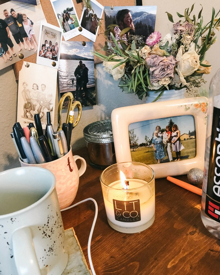 Women counselors desk with a candle and picture working on mental health blog