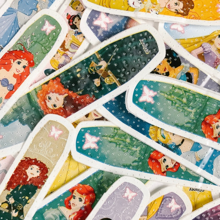 A picture of a pile of Disney princess band-aids
